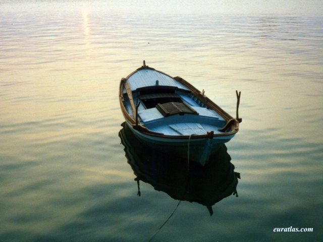 Click to download the A Fishing Boat at Sunset